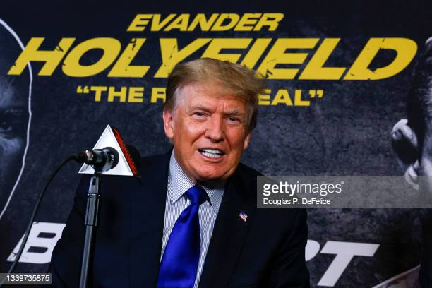 Former US President Donald Trump poses for a photo prior to the fight between Evander Holyfield and Vitor Belfort during Evander Holyfield vs. Vitor...