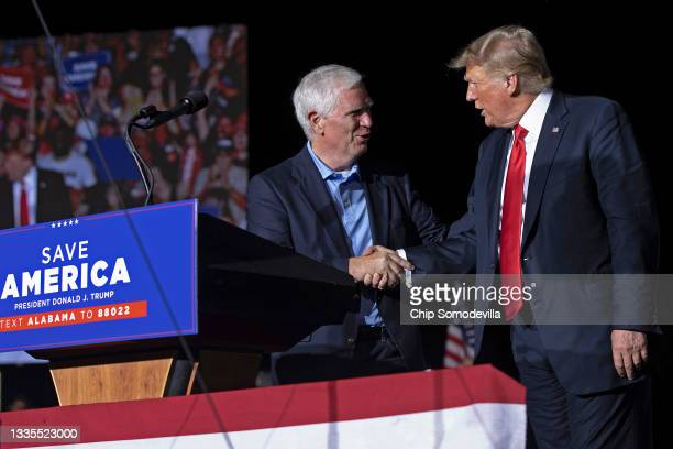 """Former U.S. President Donald Trump welcomes candidate for U.S. Senate and U.S. Rep. Mo Brooks to the stage during a """"Save America"""" rally at York..."""