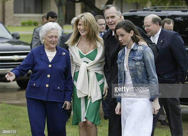 Former US President George Bush and Former First Lady Barbara Bush walk into an Easter Sunday service with their grand daughters Barbara and Jenna...