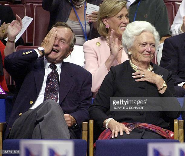 Former US President George Bush and his wife Barbara laugh during the evening session of the 2000 Republican National Convention in Philadelphia's...