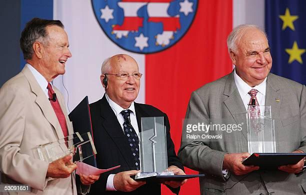 Former U.S. President George Bush, former Soviet President Mikhail Gorbatchev and former German Chancellor Helmut Kohl display their trophies during...