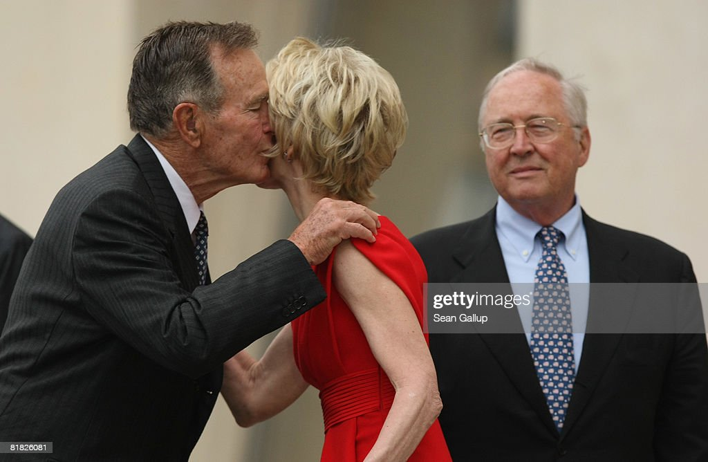 Former U.S. President George Bush (L) greets Sue Timken, wife of U.S. Ambassador to Germany William Timken, as Timken looks on during the official opening ceermony of the new U.S. embassy on July 4, 2008 in Berlin, Germany. Architectural critics claim the embassy, designed by American architect Moore Ruble Yudell, offers little in architectural innovation or design.
