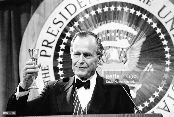 Former U.S. President George Bush offers a toast at the Ford Library rededication April 17, 1997 in Grand Rapids, Michigan.