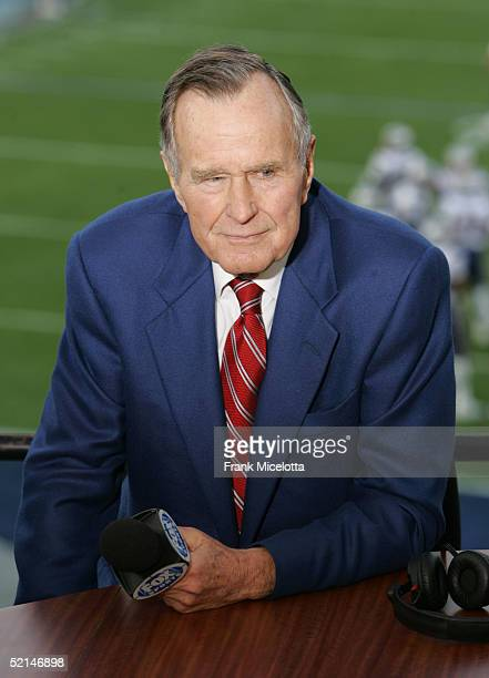 Former US President George Bush speaks at the FOX Broadcast booth during the XXXIX Superbowl pregame show at Alltel Stadium on February 6 2005 in...