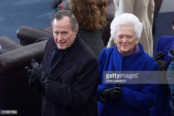 Former US President George Bush stands with wife former US first lady Barbara Bush during presidential inaugural ceremonies for their son George W...