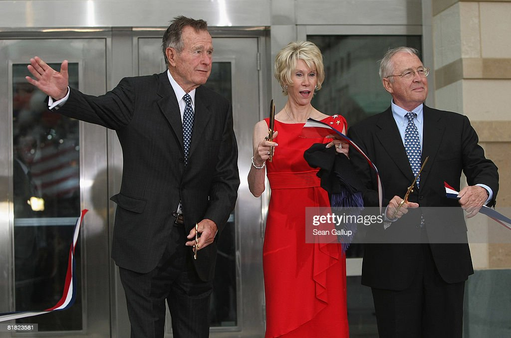 Former U.S. President George Bush (L), U.S. Ambassador to Germany William Timken and his wife Sue Timken cut the ribbon to officially open the new U.S. embassy on July 4, 2008 in Berlin, Germany. Architectural critics claim the embassy, designed by American architect Moore Ruble Yudell, offers little in architectural innovation or design.