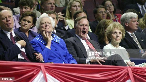 Former US President George Bush yawns as former US President Gerald Ford , former US First Lady Barbara Bush and former US First Lady Nancy Reagan...