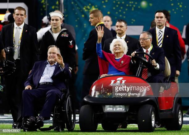 Former US President George H W Bush and former First Lady Barbara Bush are introduced prior to Super Bowl 51 between the New England Patriots and the...