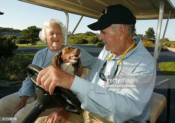 Former US president George H W Bush and wife Barbara Bush go for a drive with their 10yearold dog Millie at their home at Walker's Point August 25...