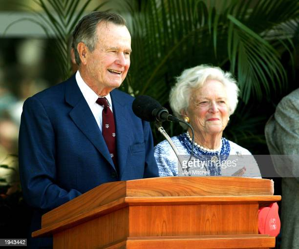 Former U.S. President George H.W. Bush and former first lady Barbara Bush attend a portrait unveiling at the George Bush Library April 21, 2003 in...