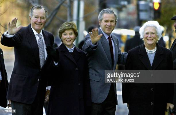 Former US President George HW Bush and his wife Barbara Bush walk into St John's Episcopal Church with their son US President George W Bush and his...
