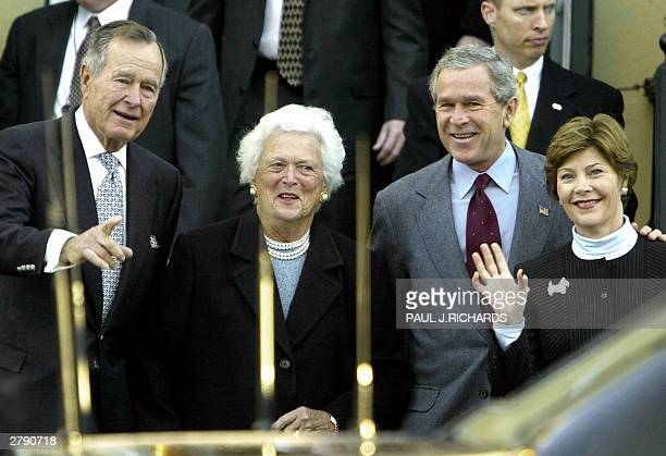 Former US President George HW Bush and his wife Barbara leave St John's Episcopal Church with their son US President George W Bush and his wife Laura...