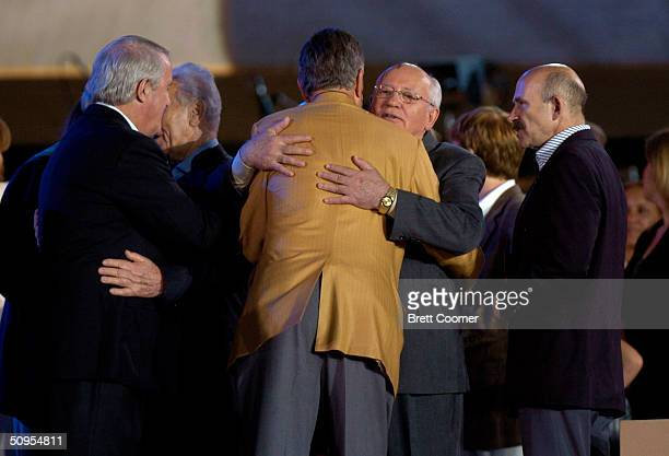 Former US President George HW Bush embraces former Soviet President Mikhail Gorbechev during former US President George HW Bush's 80th birthday...