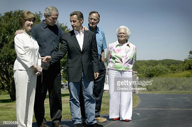 Former US president George HW Bush greets French President Nicolas Sarkozy as his wife Barbara and US President George W Bush and First Lady Laura...