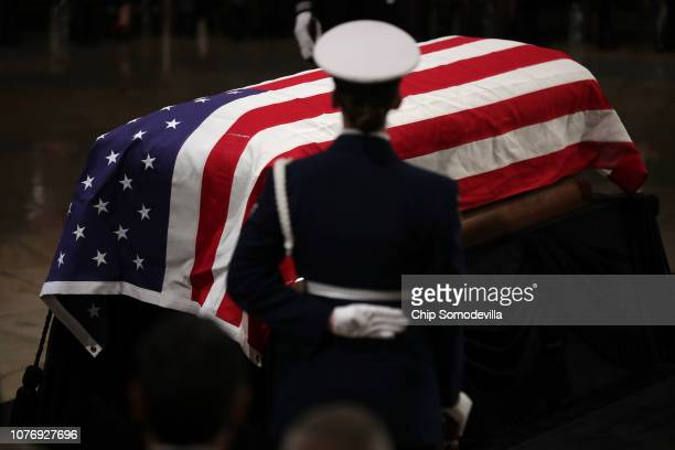 Former US President George HW Bush's flagdraped casket lies in state in the US Capitol Rotunda during an arrival ceremony December 03 2018 in...