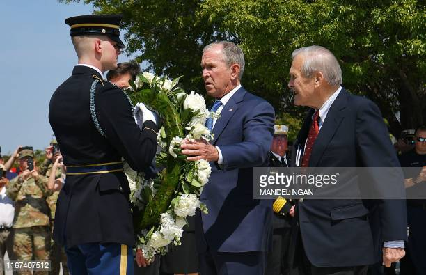 Former US President George W Bush and former Defense Secretary Donald Rumsfeld take part in a wreath laying ceremony to commemorate 9/11 at the...