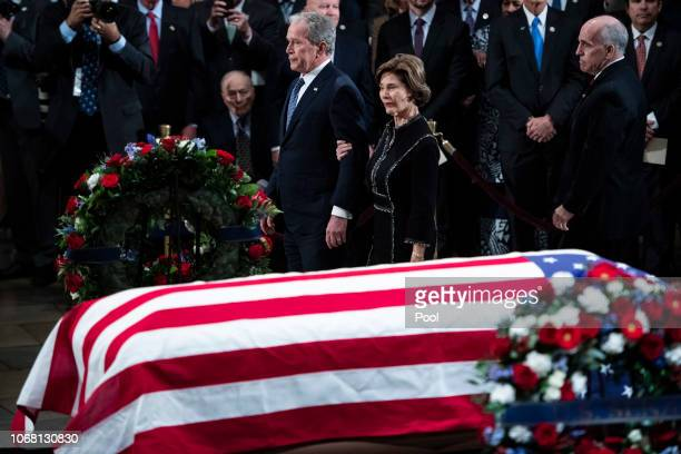 Former US President George W Bush and former first lady Laura Bush depart after ceremonies for former US President George HW Bush as he lies in state...