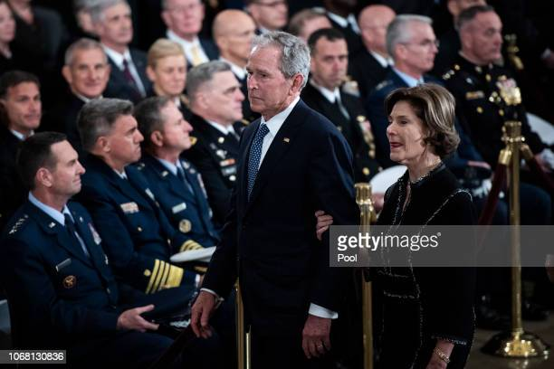 Former US President George W Bush and former first lady Laura Bush depart after ceremonies for former US President George HW Bush at the US Capitol...
