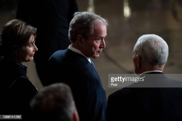 Former US President George W Bush and former first lady Laura Bush wait for the arrival of former US President George HW Bush at the US Capitol...