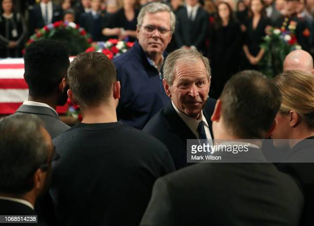 Former U.S. President George W. Bush and his brother Jeb Bush greets mourners in front of the casket of the late former President George H.W. Bush as...