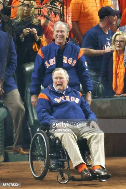 Former US President George W Bush and his father George HW Bush also a former president appear in a pregame ceremony before Game 5 of the World...