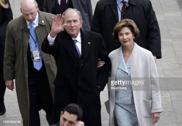 Former U.S. President George W. Bush and wife Laura Bush arrive for the 58th presidential inauguration in Washington, D.C., U.S., on Friday, Jan. 20,...