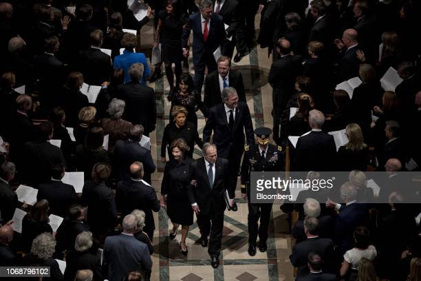Former U.S. President George W. Bush, center, and former U.S. First Lady Laura Bush exit the National Cathedral following a state funeral service for...
