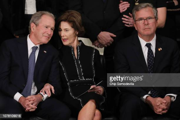 Former U.S. President George W. Bush, former first lady Laura Bush and former Florida Governor Jeb Bush attend a memorial service for former...