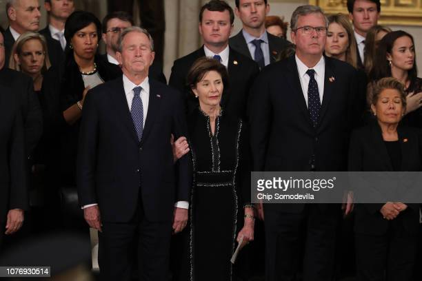 Former US President George W Bush former first lady Laura Bush former Florida Governor Jeb Bush and Columba Bush attend a memorial service for former...