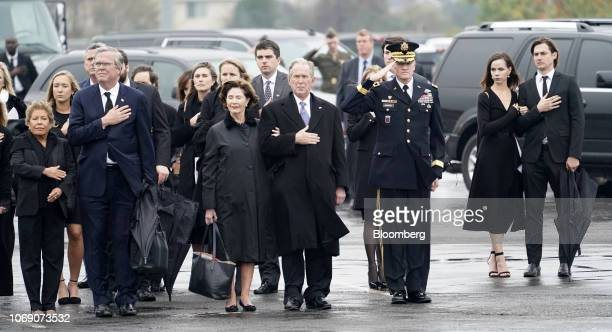 Former U.S. President George W. Bush, from center left, former U.S. First Lady Laura Bush, Jeb Bush, former governor of Florida, and his wife Columba...