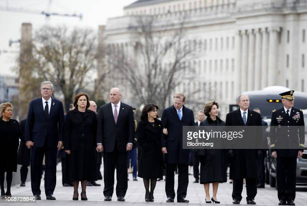 Former US President George W Bush from second right former US First Lady Laura Bush Neil Bush chairman of Points of Light Institute his wife Maria...