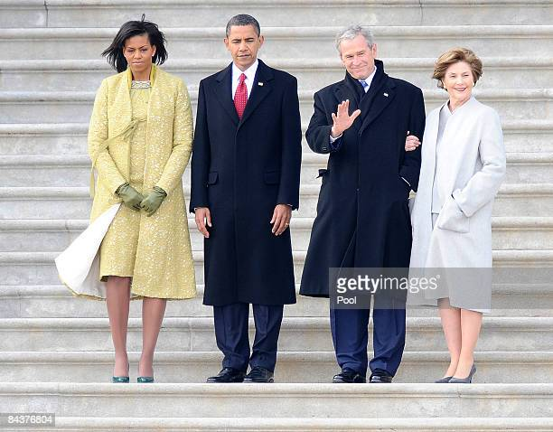 Former U.S. President George W. Bush , his wife Laura stand with President Barack Obama and first lady Michelle Obama as Bush departs from the U.S....