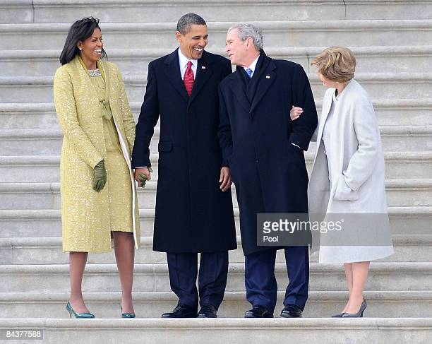 Former US President George W Bush his wife Laura stand with President Barack Obama and First Lady Michelle Obama as Bush departs from the US Capitol...