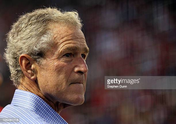 Former US President George W Bush looks on during Game One of the ALCS during the 2010 MLB Playoffs between the New York Yankees and the Texas...