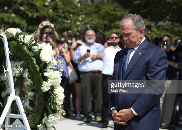 Former US President George W Bush participates in a wreathlaying ceremony at the 9/11 Pentagon Memorial to commemorate the anniversary of the...