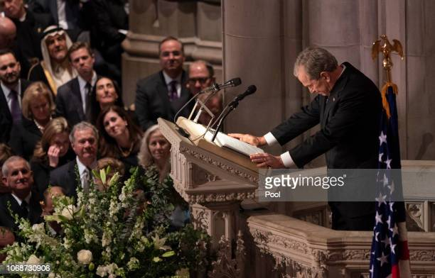 Former US President George W Bush pauses for a moment while giving a eulogy during the state funeral service of his father former President George HW...