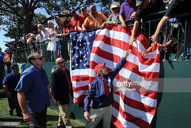 Former US President George W Bush shakes hands with spectators during day two of the Afternoon FourBall Matches for The 39th Ryder Cup at Medinah...
