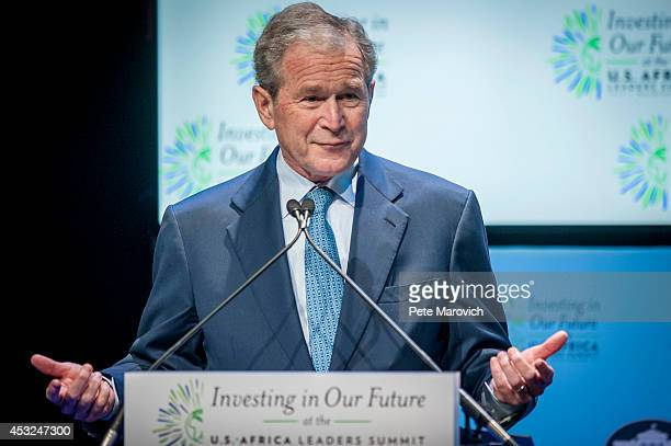 Former US President George W Bush speaks at a Spousal Symposium at the John F Kennedy Center for the Performing Arts on August 6 2014 in Washington...