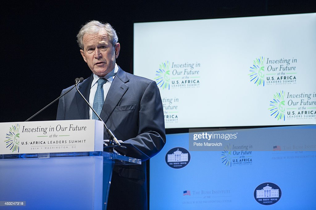 Former U.S. President George W. Bush speaks at a Spousal Symposium at the John F. Kennedy Center for the Performing Arts on August 6, 2014 in Washington, DC. The symposium, sponsored by first lady Michelle Obama and former first lady Laura Bush, focuses on the role the spouses of world leader's play and the impact of investments in education, health, and economic development through public-private partnerships.