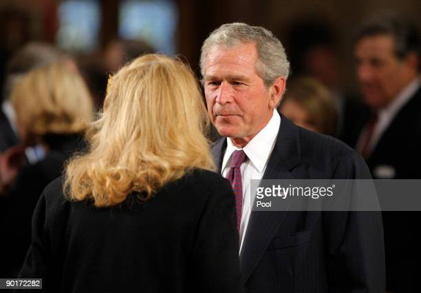 Former US President George W Bush talks with US Senator Edward Kennedy's exwife Joan Kennedy during funeral services for Sen Kennedy at the Basilica...