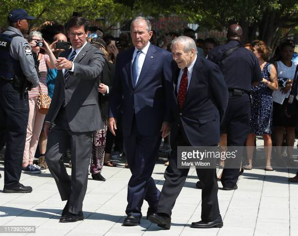 Former US President George W Bush US Secretary of Defense Mark Esper and former US Secretary of Defense Donald Rumsfeld participate in a wreathlaying...