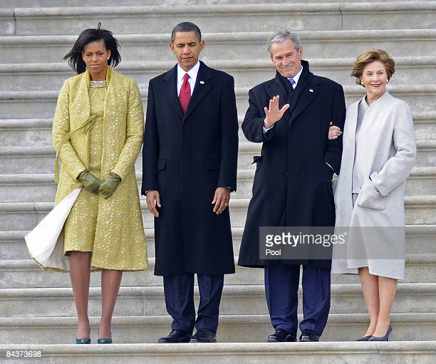 Former US President George W Bush waves as he and his wife Laura stand with President Barack Obama and First Lady Michelle Obama as Bush departs from...