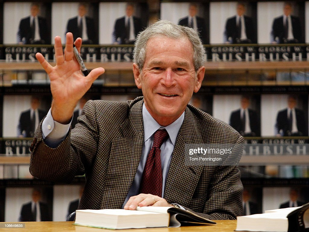 Former U.S. President George W. Bush waves while signing copies of his new memoir 'Decision Points' at Borders Books on November 9, 2010 in Dallas, Texas. Hundreds of people lined up, starting Monday night, for the chance to purchase signed copies of 'Decision Points' at the North Dallas bookstore.