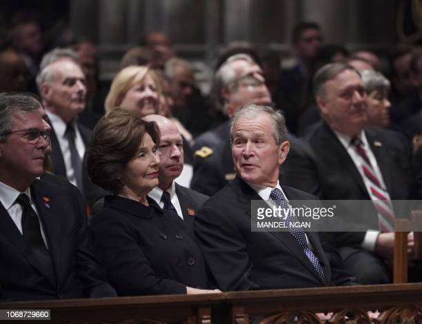 Former US President George W Bushformer US First Lady Laura Bush and Jeb Bush attend the funeral service for former US president George H W Bush at...