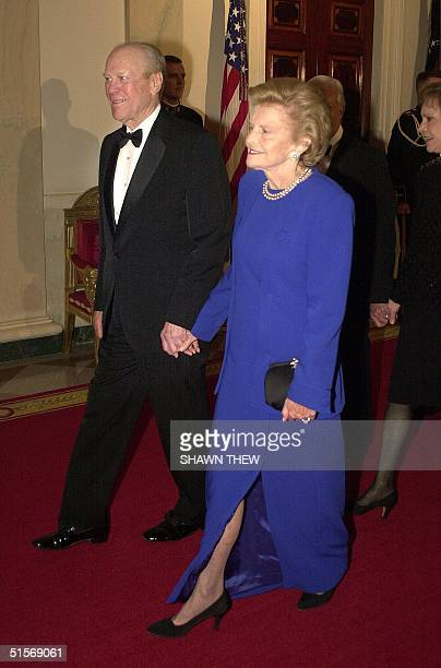 Former US President Gerald Ford and his wife former First Lady Betty Ford walk into the East Room of the White House in Washington DC for The 200th...