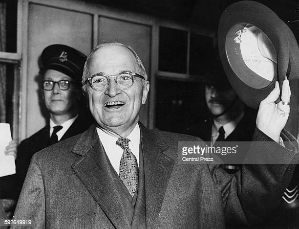 Former US President Harry S Truman doffing his hat as he arrives in England 1956