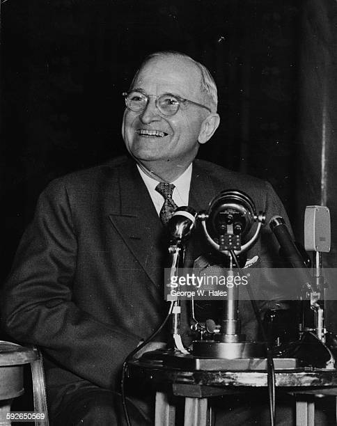 Former US President Harry S Truman smiling during a press conference at the Savoy Hotel in London, June 18th 1956.