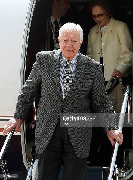 Former US President Jimmy Carter accompanied with his wife Rosalynn arrives at Queen Alia International airport on April 20 2008 in Amman Jordan...