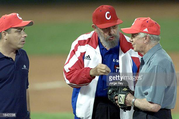 Former US President Jimmy Carter and Cuban President Fidel Castro talk after a friendly game of baseball at the Latinoamericano Stadium May 14 2002...