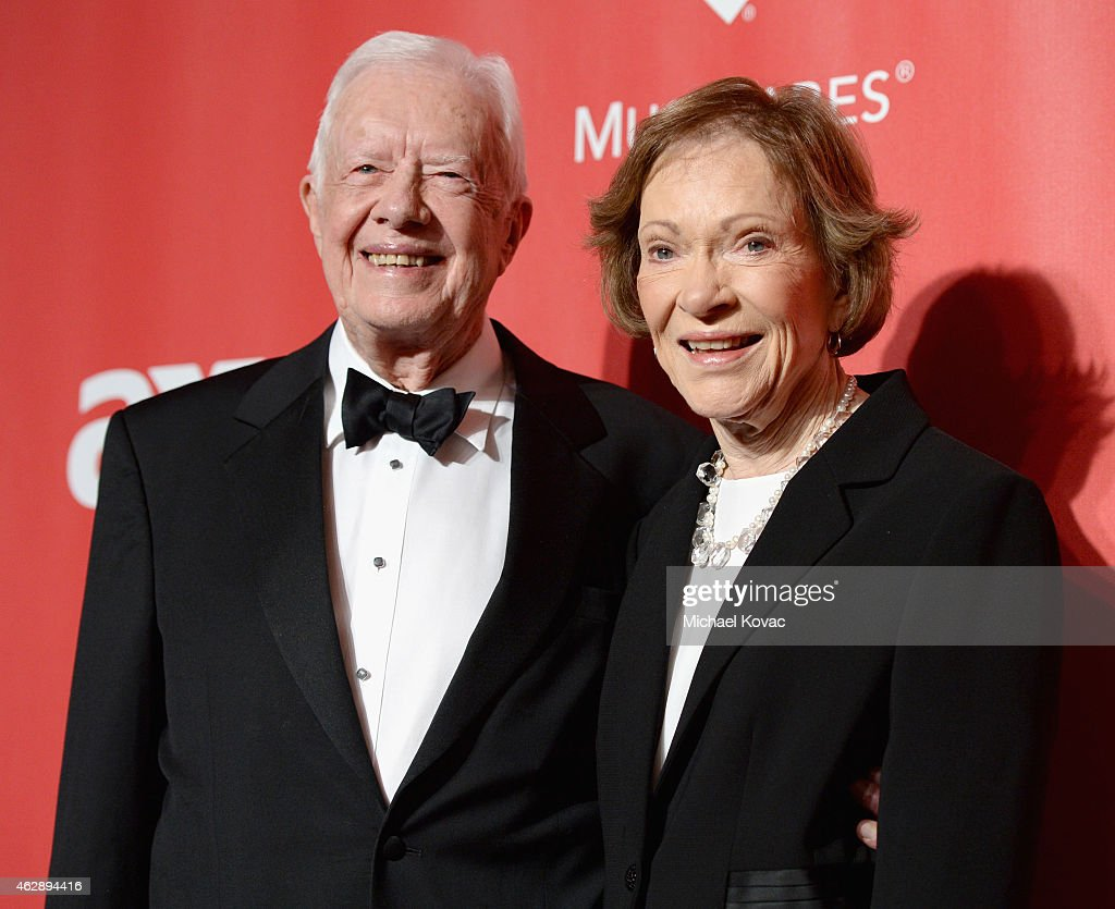 Former U.S. President Jimmy Carter (L) and former First Lady Rosalynn Carter attend the 25th anniversary MusiCares 2015 Person Of The Year Gala honoring Bob Dylan at the Los Angeles Convention Center on February 6, 2015 in Los Angeles, California. The annual benefit raises critical funds for MusiCares' Emergency Financial Assistance and Addiction Recovery programs. For more information visit musicares.org.